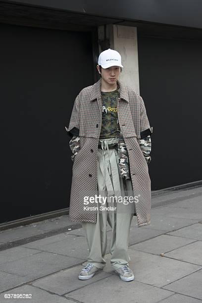 Creative Director Jyong Kim wears a Balenciaga cap Raf Simmons jacket Gosha Rubchinskiy T Shirt Xander Zhou army jacket and trainers and Craig Green...