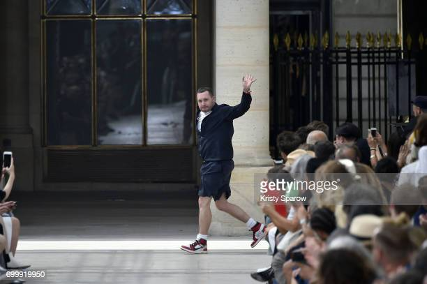 Creative Director Kim Jones acknowledges the audience during the Louis Vuitton Menswear Spring/Summer 2018 show as part of Paris Fashion Week on June...
