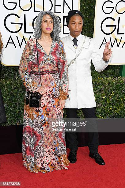 Creative director Mimi Valdes and musician Pharrell Williams attend 74th Annual Golden Globe Awards held at The Beverly Hilton Hotel on January 8...
