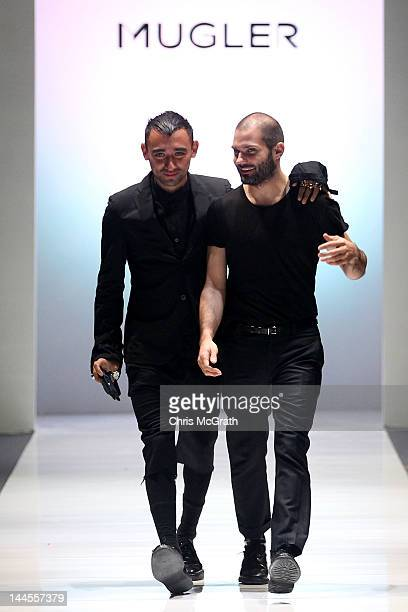 Creative director Nicola Formichetti and designer Thierry Mugler walk the runway during the Audi Fashion Festival Opening Show of Mugler A/W 2012...