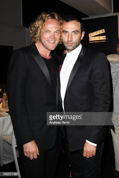 Creative director of Emilio Pucci Peter Dundas and Givenchy Designer Riccardo Tisci attend the Style Star Night Party at Carlton Beach during the...