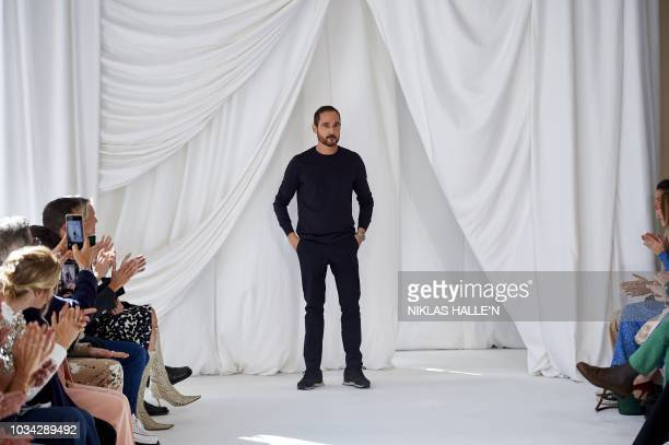 Creative director of fashion house Delpozo Josep Font receives the audience's applause after a catwalk show for the Spring/Summer 2019 collection on...