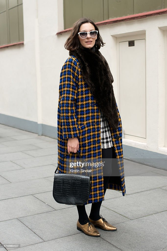 Creative Director of Secret D'Or Magazine Andreea Bogdan wears Jean La Fore sunglasses, Invito shoes, vintage bag and scarf and a Prestige coat on day 4 of London Collections: Women on February 17, 2014 in London, England.