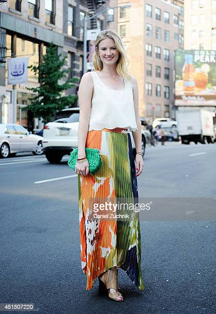 Creative Director Olivia White is seen around Soho wearing an Alice and Olivia skirt Dolce Vita shoes and a Prada purse on June 30 2014 in New York...