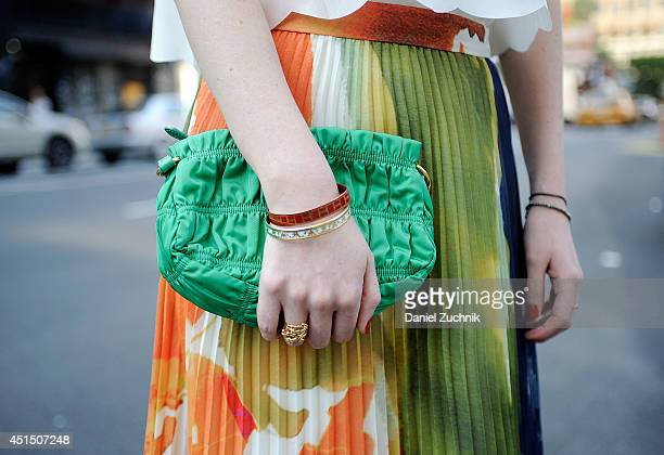 Creative Director Olivia White is seen around Soho wearing an Alice and Olivia skirt and a Prada purse on June 30 2014 in New York City