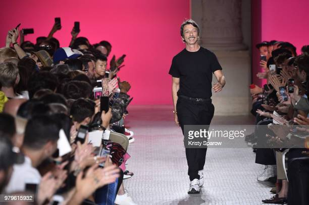 Creative Director Pierpaolo Piccioli acknowledges the audience during the Valentino Menswear Spring/Summer 2019 show as part of Paris Fashion Week on...