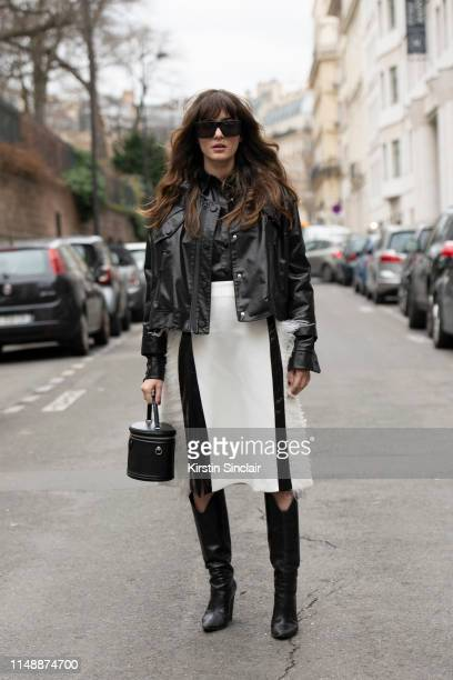 Creative Director, Producer and Co-Founder of Grumble creative agency Eleonora Carisi wears Tom Ford sunglasses, Louis Vuitton bag, Magda Butrym...