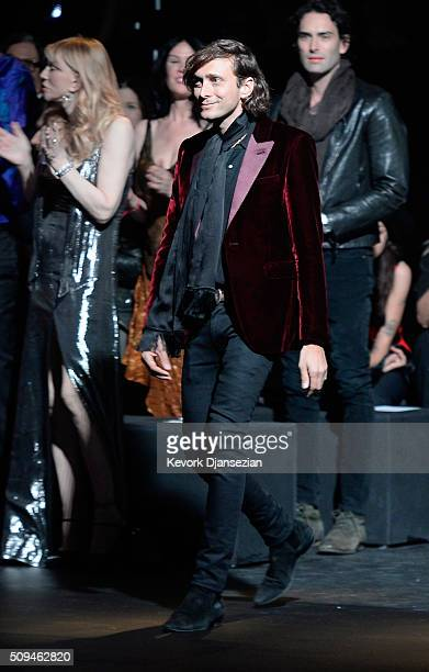 Creative Director Saint Laurent Paris Hedi Slimane walks the runway during the Saint Laurent show at The Hollywood Palladium on February 10 2016 in...
