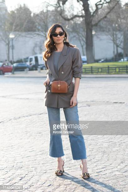 Creative Director Sofya Benzakour wears a Rochas bag and shoes YSL jacket Levi's jeans on February 27 2019 in Paris France