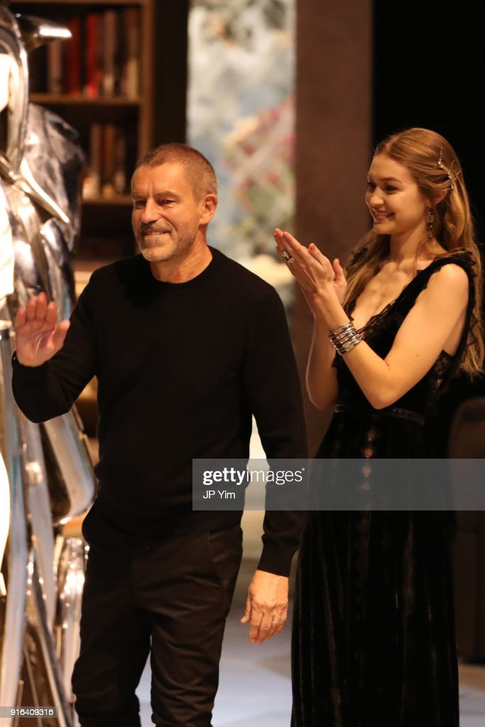 Creative Director Tomas Maier and Gigi Hadid acknowledge the guests at the end of the Bottega Veneta Fall/Winter 2018 Collection at the American Stock Exchange on February 9, 2018 in New York City.