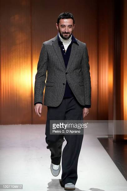 Creative Director Walter Chiapponi acknowledges the applause of the audience during the Tod's fashion show as part of Milan Fashion Week Fall/Winter...
