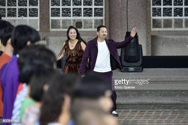 Creative Directors Carol Lim and Humberto Leon acknowledge the audience during the Kenzo Menswear Spring/Summer 2018 show as part of Paris Fashion...
