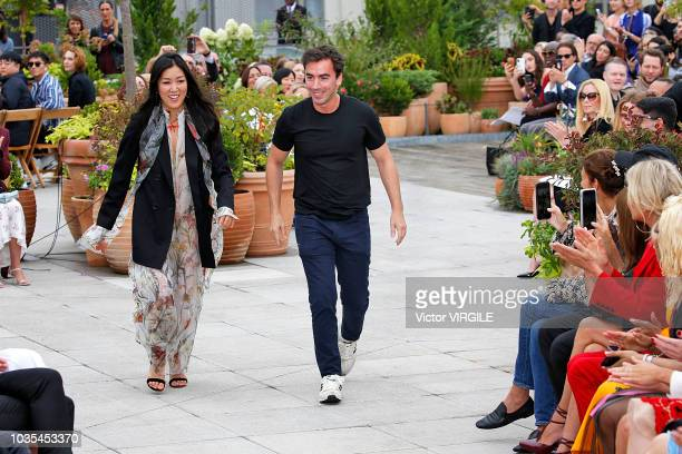 Creative directors Fernando Garcia and Laura Kim walk the runway at the Oscar De La Renta Ready to Wear Spring/Summer 2019 fashion show during New...