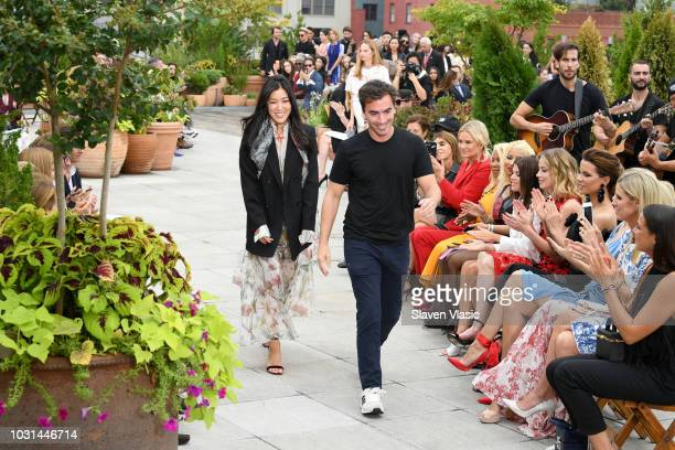 Creative directors Fernando Garcia and Laura Kim walk the runway for Oscar De La Renta during New York Fashion Week The Shows at Spring Studios...