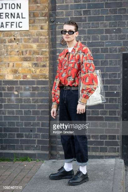 Creative display stylist Callum Hobson wears a Burberry shirt vintage Helmut Lang jeans Royal Mail issue Dr Martens shoes Asos sunglasses and a...