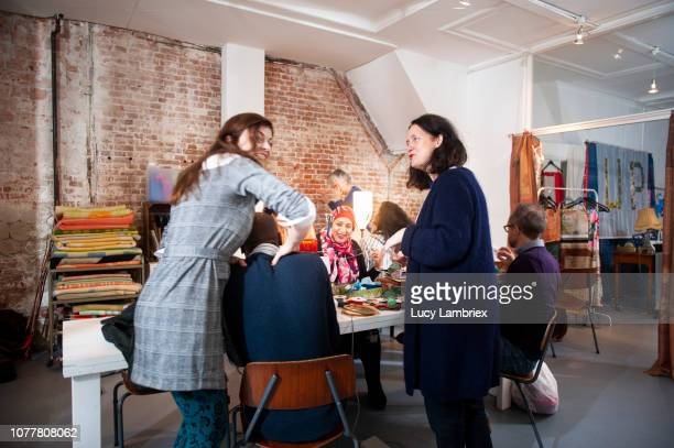 creative, diverse, business team experimenting in their workshop - massage funny stock pictures, royalty-free photos & images