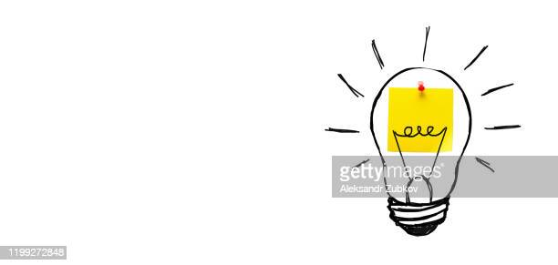 creative drawing of a light bulb on a yellow sticker, on a white background. the concept of new ideas, innovations, solutions to problems. banner. - blackboard stock pictures, royalty-free photos & images