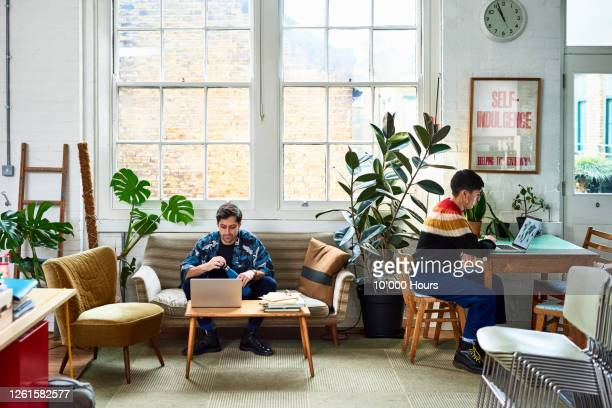 creative entrepreneurs working in stylish office - top garment stock pictures, royalty-free photos & images