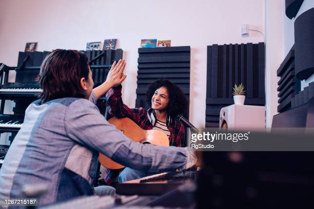 creative female musicians   successfully cooperating while making a new song - singer songwriter stock pictures, royalty-free photos & images