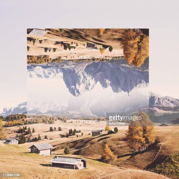creative geometric landscape manipulation with reflection in the italian alps. - terugtrekken stockfoto's en -beelden