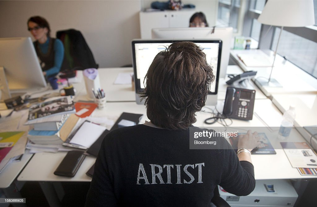 A creative is seen working on a project using an Apple Inc. computer in the offices of Havas SA in Paris, France, on Friday, Dec. 14, 2012. Havas SA, the French advertising company which is known for memorable advertising campaigns, including the 2009 commercials for Evian water that featured babies on roller skates. Photographer: Balint Porneczi/Bloomberg via Getty Images