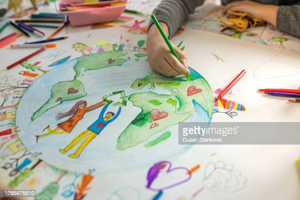 creative kids drawing on paper - earth day stock pictures, royalty-free photos & images