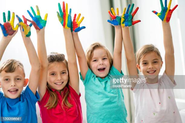 creative kids - 4 girls finger painting stock pictures, royalty-free photos & images