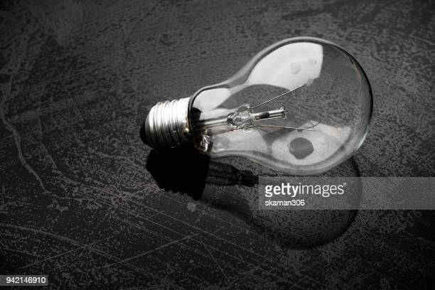 Creative light bulb and splash water on background