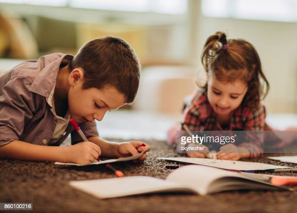 two kids relaxing carpet drawing paper