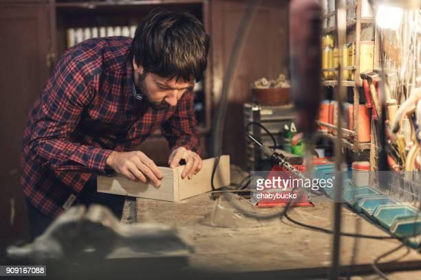 Creative man making wooden box