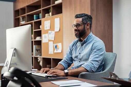 Creative man working on computer 1059660850