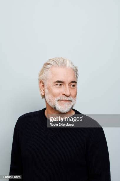 creative mature man with grey hair on blue background - creative director stock pictures, royalty-free photos & images
