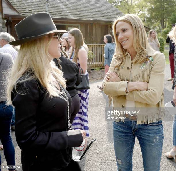 Creative of Big Machine Label Group Sandi Spika Borchetta and singersongwriter Sheryl Crow chat during a special day revealing Sheryl Crow Johnny...
