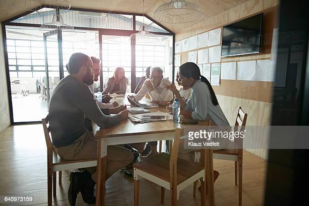 Creative people having brainstorm meeting