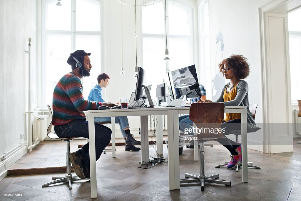 Creative people working at startup : Stock Photo