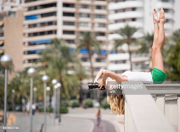 Creative Perspective, Woman taking a Picture over head