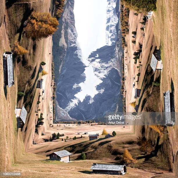 creative picture bending the landscape of the beautiful dolomites mountains with meadows and alpine houses. - alto adige italy stock pictures, royalty-free photos & images