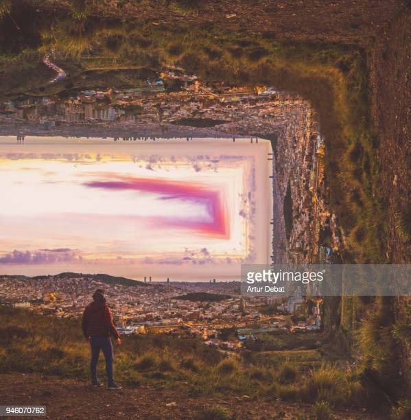creative picture bending the landscape with guy contemplating the barcelona cityscape during sunrise from hill viewpoint. - reportaje imágenes stock pictures, royalty-free photos & images