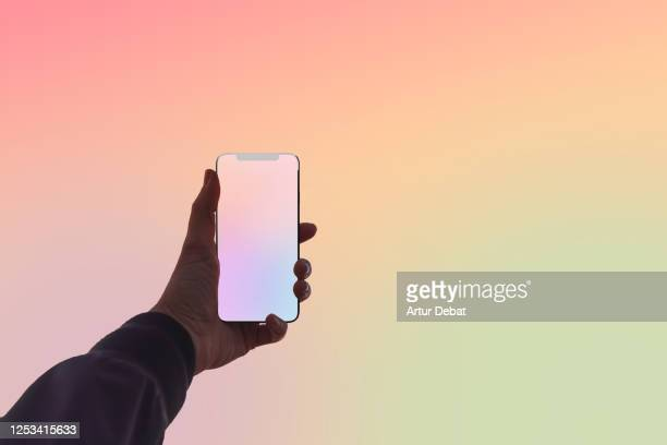 creative picture capturing the colors of sunset sky with mobile phone. - social media stock pictures, royalty-free photos & images