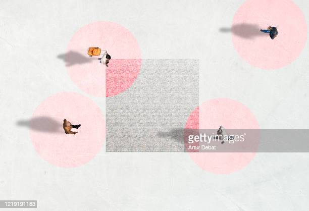creative picture from above of people walking with social distancing and red circles. - distancia social fotografías e imágenes de stock