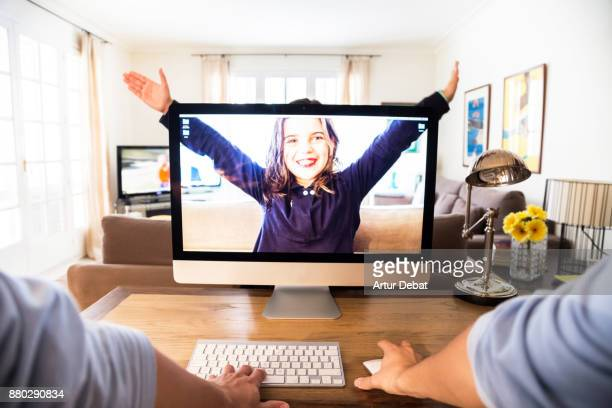 Creative picture of a guy working from home with personal perspective with kid playing behind the screen computer with transparency and playing with perspective in a original idea.