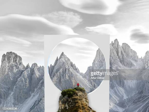 creative picture of huge geometric shape with circle in middle of nature with dolomites mountains and hiker. - modern rock stock pictures, royalty-free photos & images