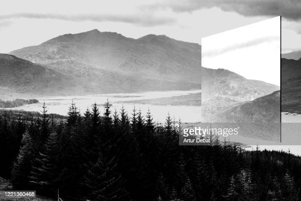 creative picture of huge mirror reflecting dramatic landscape in the scottish highlands. - bizarre stock pictures, royalty-free photos & images