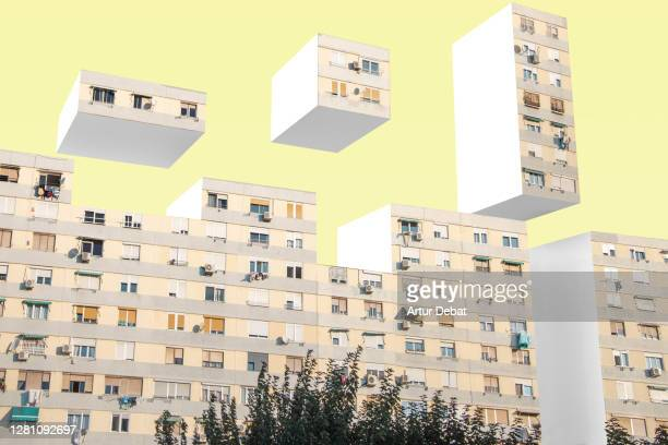 creative picture of urban blocks stacking like video game in surreal image manipulation. - building exterior stock pictures, royalty-free photos & images