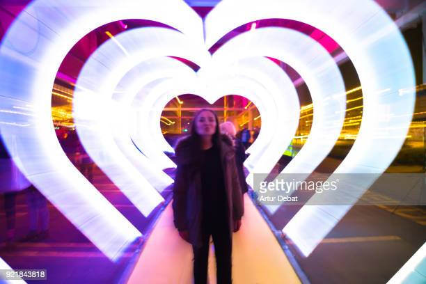creative picture with zoom technique of illuminated hearts creating tunnel effect with light trails. - image stock pictures, royalty-free photos & images