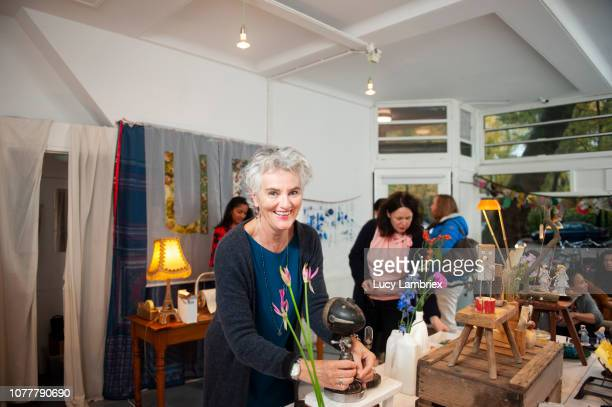 creative pop up store selling upcycled goods from several local artists - pop up store stock pictures, royalty-free photos & images