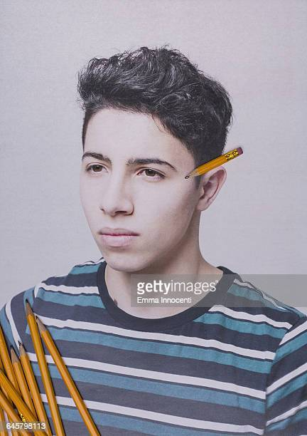 Creative portrait of student with pencil on ear