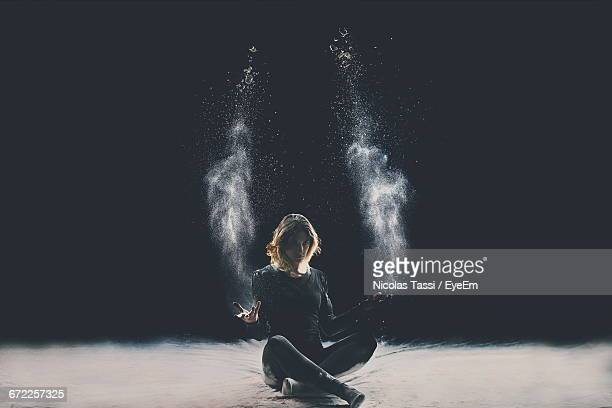 creative portrait of young woman against black background - dust dark stock photos and pictures