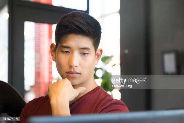Creative professional looking at monitor in modern office