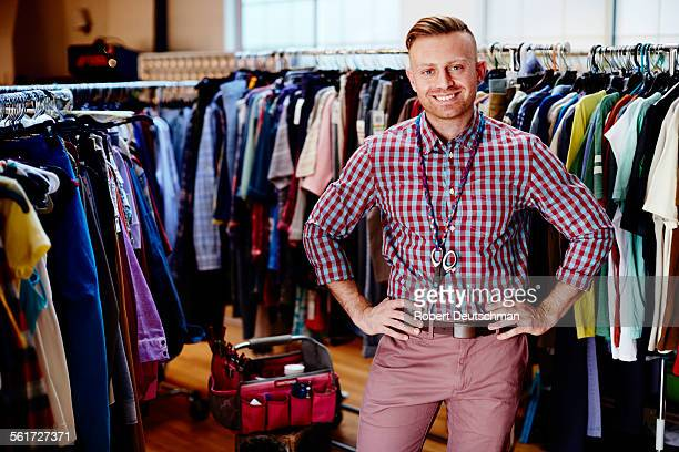 A creative professional man standing with clothes.